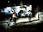 biker under bridge